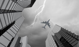 Airplane above city Stock Images