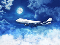 Airplane above the clouds Stock Photography