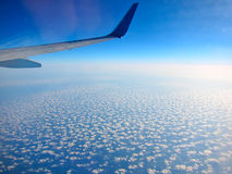 Airplane above clouds Stock Images