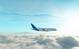 Airplane above the clouds stock images