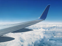 Airplane above Clouds stock image