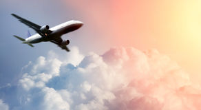 Airplane above the clouds. Photo of Airplane above the clouds Royalty Free Stock Image