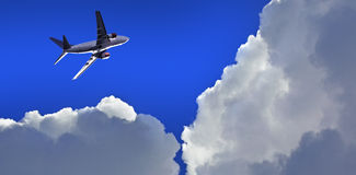 Airplane above the clouds Royalty Free Stock Photo