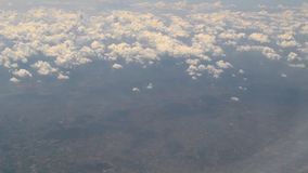 Airplane above clouds stock video footage