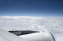 Airplane above the clouds Royalty Free Stock Photos