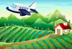 An airplane above the farm Royalty Free Stock Photos