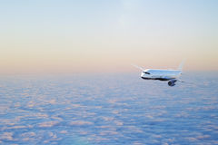 Airplane above the Royalty Free Stock Photography
