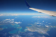 airplane above many islands Stock Photos