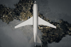 Airplane above night landscape. Top view of airplane and clouds above night landscape. 3D Rendering Stock Images