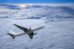 Airplane above Sunset Royalty Free Stock Photo