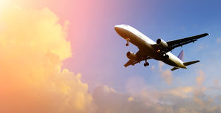Airplane Above The Clouds Royalty Free Stock Photography