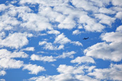 Airplane. Across the blue sky Stock Image