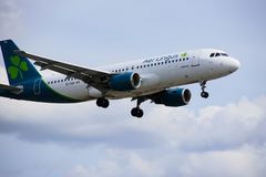 Airplane of Aer Lingus airlines. Flying in the sky, airbus A320 royalty free stock photography