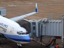 Airplane & Aerobridge Royalty Free Stock Photo