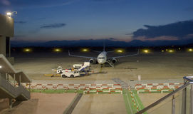 Airplane in aeroport Stock Image