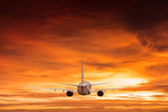 Airplane aft plane. In the sky at sunset sky Royalty Free Stock Photography