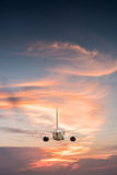 Airplane aft plane. In the sky at sunset sky Stock Photography