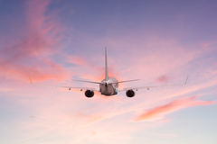 Airplane aft plane. In the sky at sunset sky Stock Photo