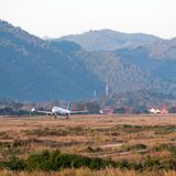 The airplane against the background of the Laotian landscape in Stock Images