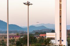 The airplane against the background of the Laotian landscape in Louangphabang, Laos. Copy space for text. Royalty Free Stock Photography