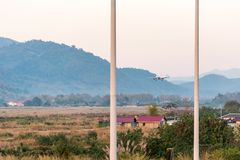 The airplane against the background of the Laotian landscape in Louangphabang, Laos. Copy space for text. Royalty Free Stock Photo