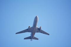 Airplane against blue sky Royalty Free Stock Photo