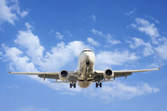 Airplane. Against cear blue sky Stock Image