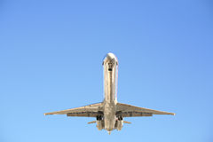 Airplane against clear blue sky. Airplane closeup against a clear blue sky Stock Image