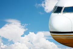 Airplane in the air. Jumbo jet in mid flight with sky clouds in the background stock image