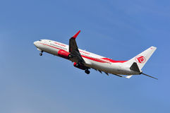 Airplane of Air Algerie above Frankfurt airport Royalty Free Stock Photo