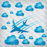 Airplane in the air with blue clouds Stock Photography