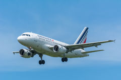 Airplane Air France F-GUGF Airbus A318-100 is flying to the runway. Stock Photo