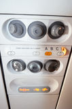 Airplane air and light controls. Photo of an commercial airplane light and air control panel Royalty Free Stock Photography