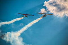 Airplane air show team smoke trail Synchronized Royalty Free Stock Photos