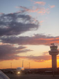 Airplane and air traffic control tower at airport Royalty Free Stock Photo