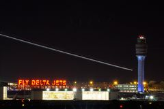 Airplane and air traffic control tower. Airplane leaving Atlanta Hartsfield Airport Royalty Free Stock Photography