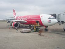 Airplane of AirAsia X Berhad at Taoyuan International Airport, Taiwan. Taoyuan, Taiwan - March 4, 2015: Jet airplane Airbus A330-200 of AirAsia X Berhad at Stock Photography
