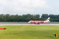 Airplane of AirAsia low-cost airline taxis in airport Royalty Free Stock Photos