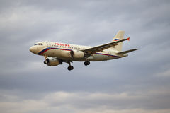 Airplane Airbus A3319-111 (VQ-BAT) airlines Russia flying in the cloudy evening sky Stock Photography