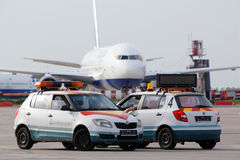 Airplane and airdrome car Follow Me. MOSCOW - MAY 22:  Airplane and airdrome car Follow Me at Domodedovo airport, May 22, 2012, Moscow, Russia. Domodedovo Stock Image