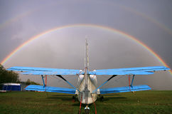 AN-2 airplane on the airfield. Rainbow over the sky. Kozelsk russia Royalty Free Stock Images