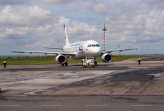 Airplane airline `Ural Airlines` towed to the runway Simferopol Airport Royalty Free Stock Photo