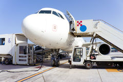 Airplane in airport Royalty Free Stock Image