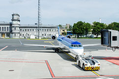 Airplane at airport. Airplane being towed to ramp at airport Stock Photos