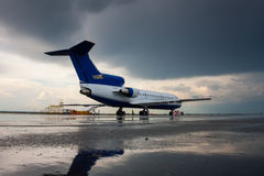 Airplane on the airport apron stock images