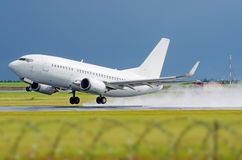 Airplane airport flight takeoff rain splashes.  Royalty Free Stock Photography