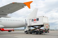 Airplane at the airport with loading ladder for disabled people. Airplane at the airport with loading ladder for disabled people Royalty Free Stock Photos