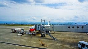 Airplane on Airport Near Plane Stairs Royalty Free Stock Photos