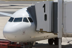 Airplane at an Airport With Passenger Gangway Stock Photos