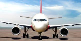 Airplane on airport runway preparing to take off Stock Photos